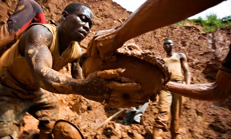 Congo mine collapse – workers form a human chain while digging an open pit in Kilomoto, north-east of the country. Photograph: Finbarr O'Reilly/Reuters