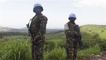 U.N. peacekeepers from Tanzania hold their weapons as they patrol outside Goma during a visit by officials from the U.N. Security Council in the eastern DRC