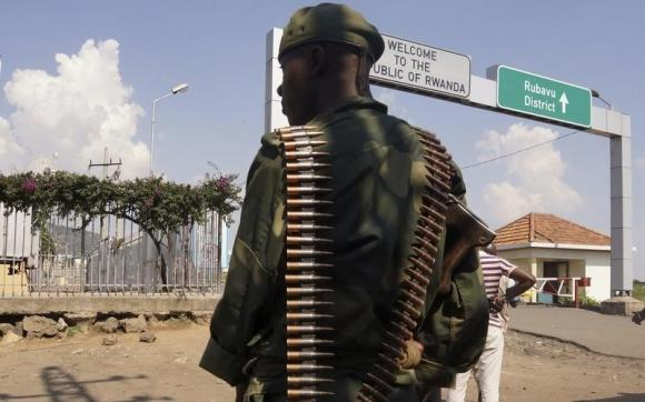A Congolese FARDC soldier stands near the border crossing point with Rwanda in Goma