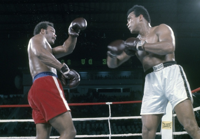 Muhammad ali right and george foreman in action in kinshasa ali