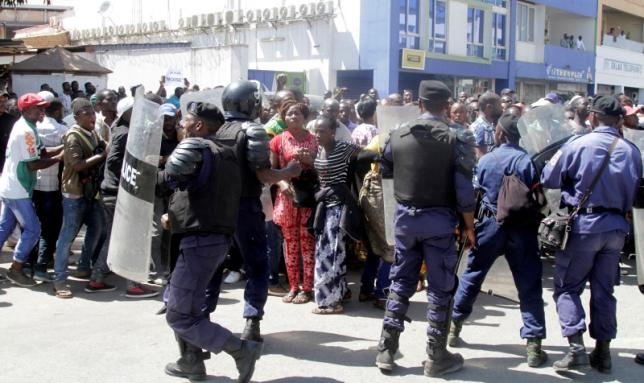 Riot police disperse supporters of DRC's opposition Presidential candidate Katumbi as they escort him to the prosecutor's office over government allegations he hired mercenaries in a plot against the state in Lubumbashi