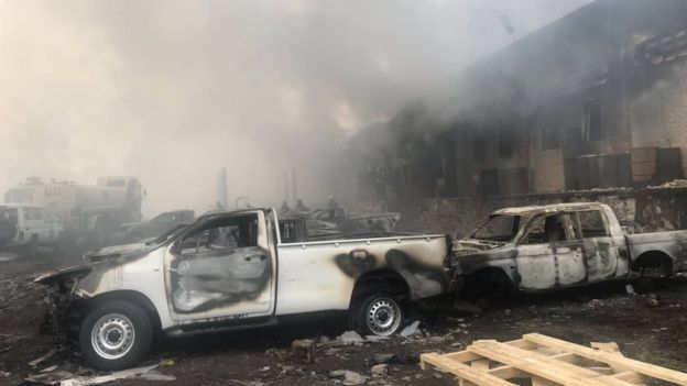 A photo released by the election commission (CENI) shows vehicles damaged by the fire